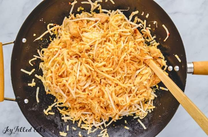 the shirataki noodles added to the skillet for the chicken pad thai
