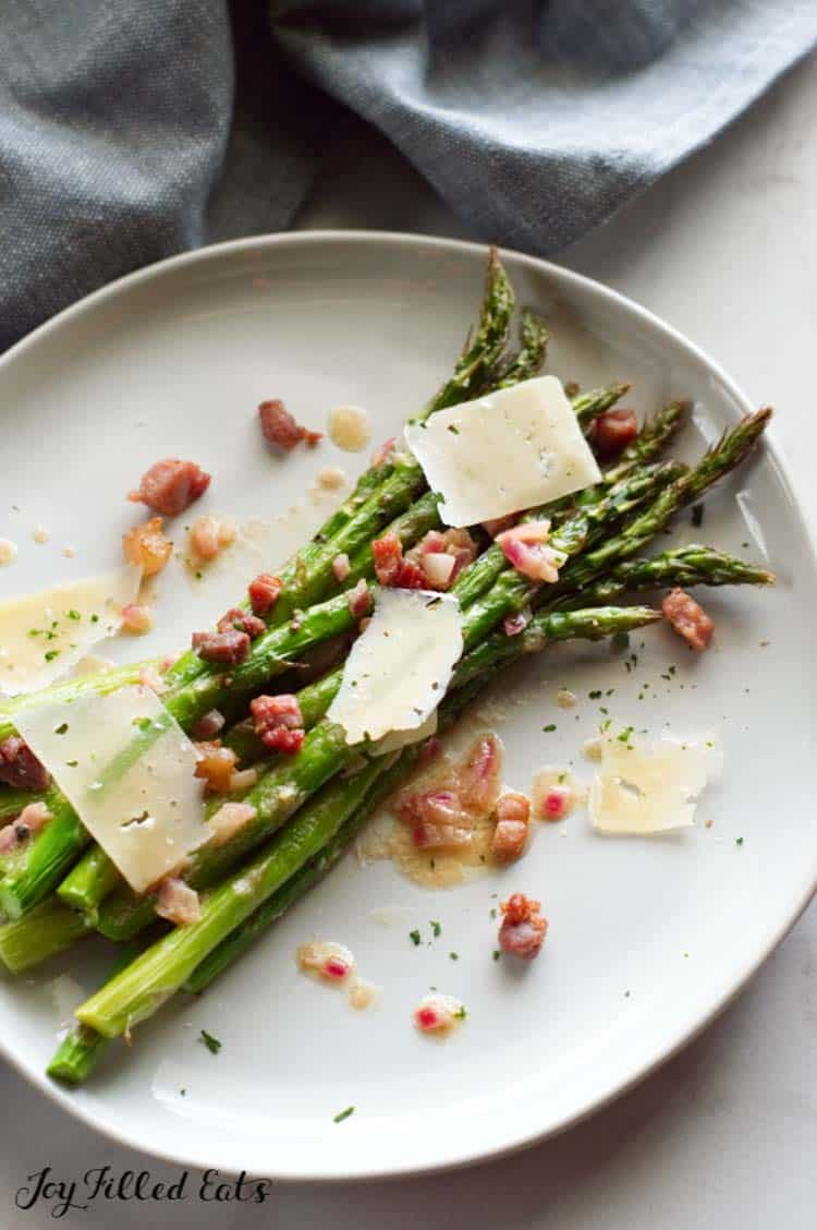 a plate with oven roasted asparagus with parmesan