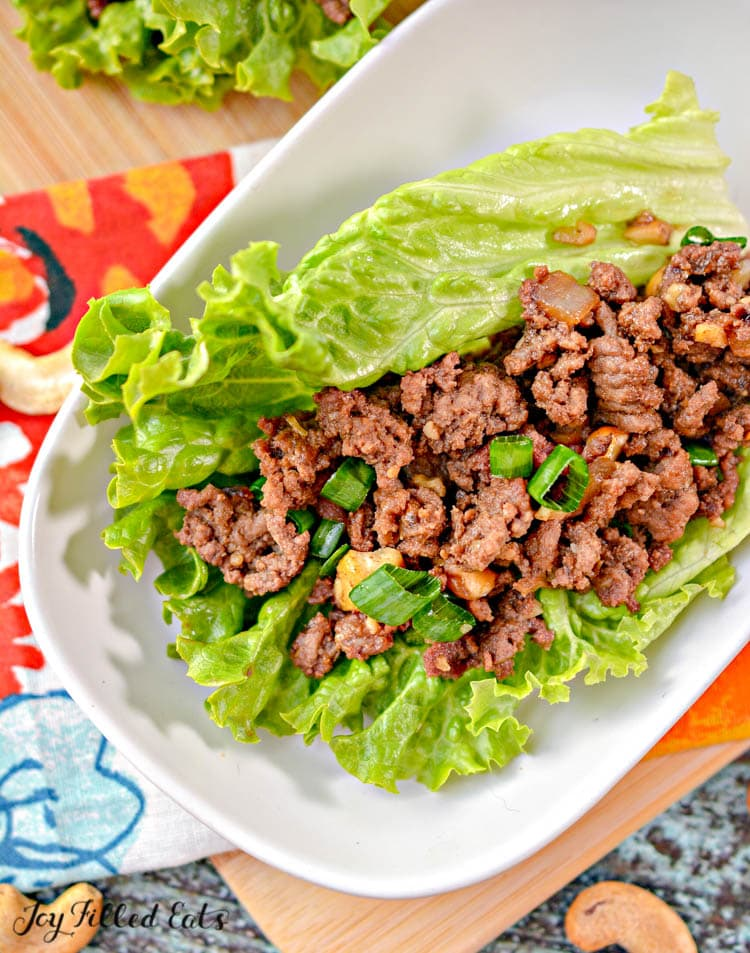 overhead shot of the asian lettuce wraps on a white plate