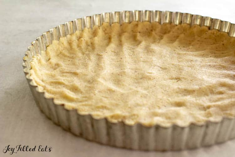 low carb pie crust pressed into a tart pan