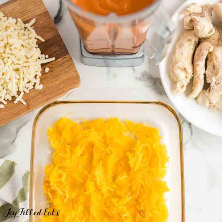 cooked spaghetti squash in the casserole dish