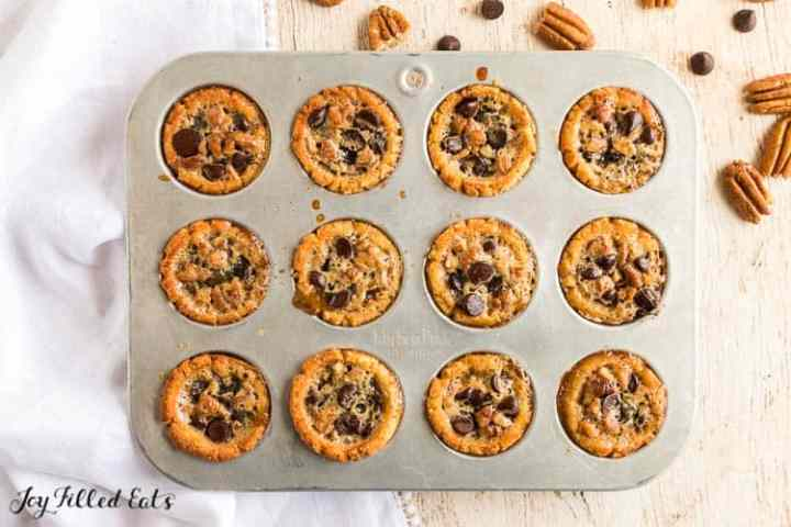 pecan tassies with chocolate chips in a mini muffin pan