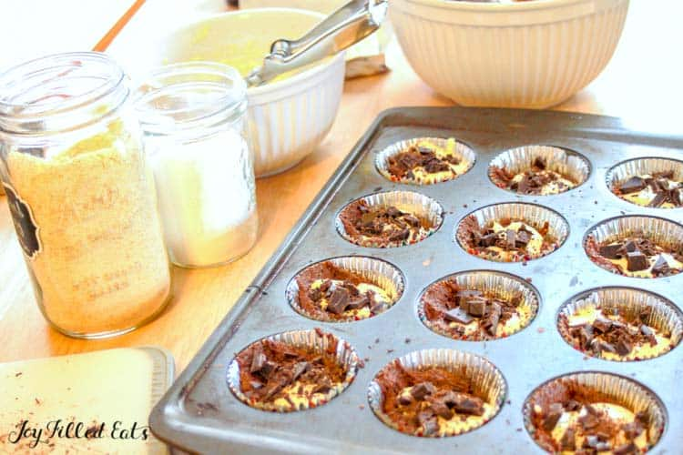 a muffin tin with the batter for black bottom cupcakes