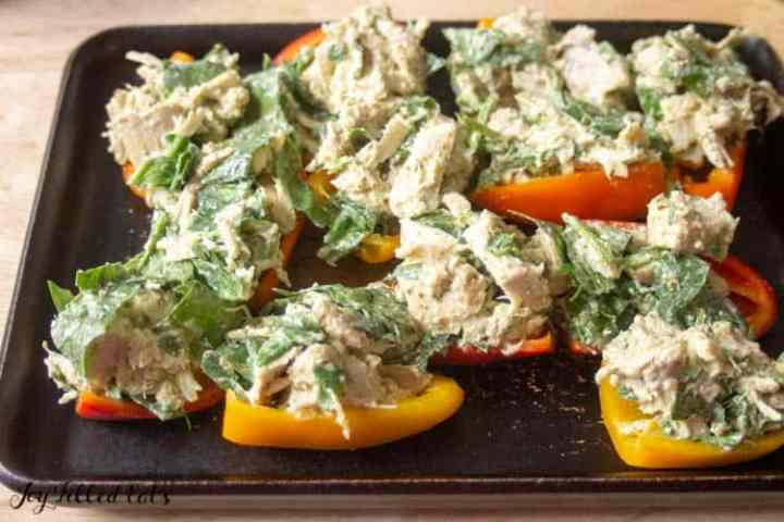 mini stuffed peppers topped with chicken and spinach