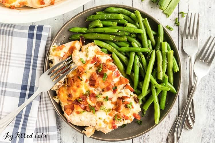 chicken from the crack chicken recipe on a plate with green beans