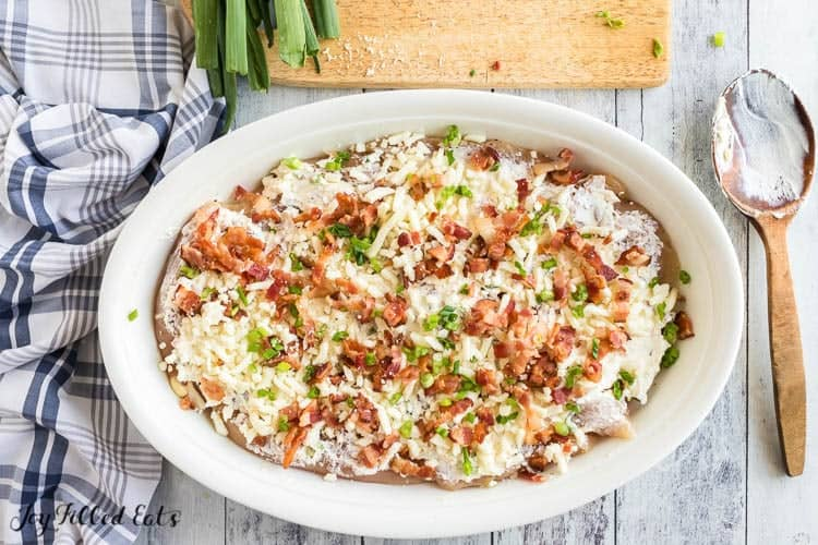 crack chicken covered with bacon, mozzarella, and green onions