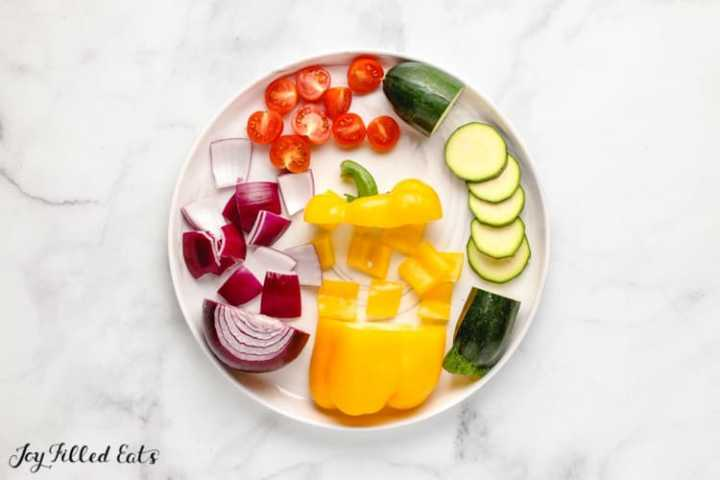 cut vegetables on a white plate