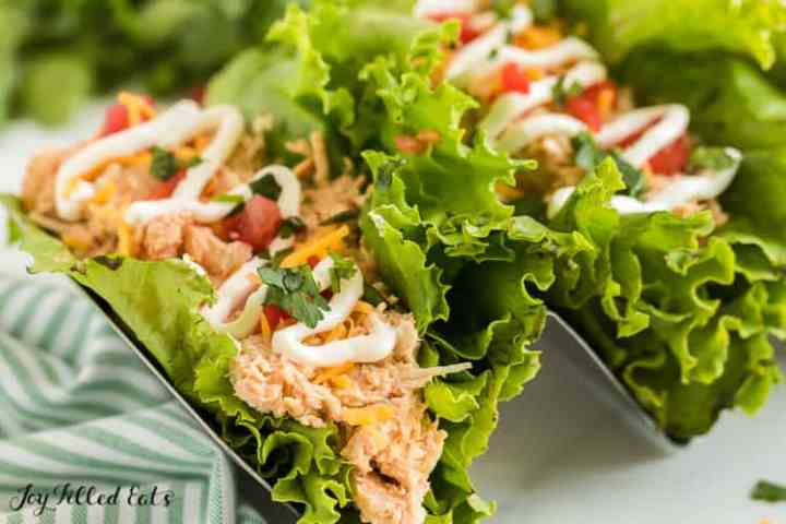 closeup of one of the lettuce wrap crockpot chicken tacos