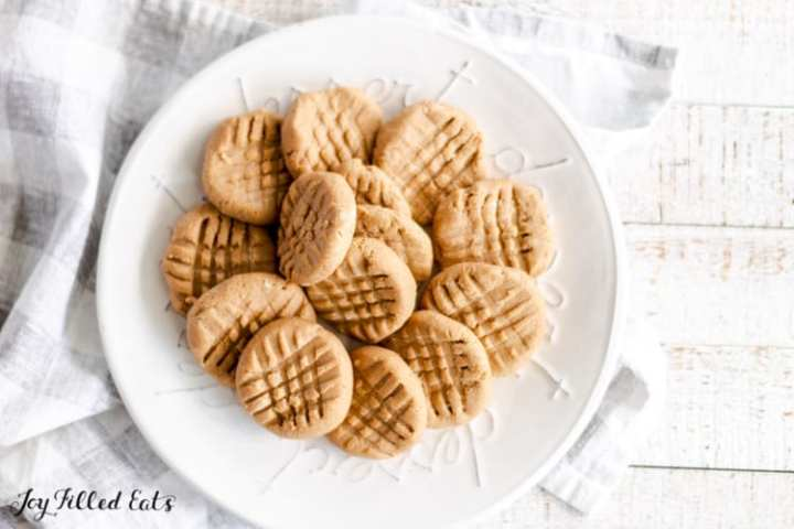 a white plate of peanut butter no bake cookies