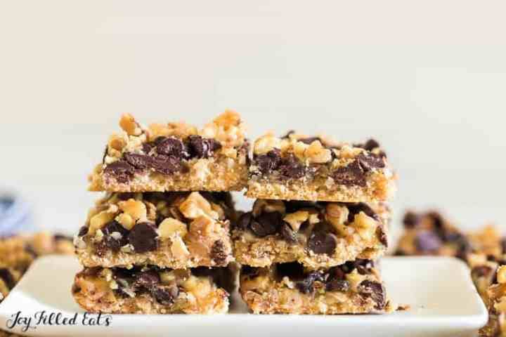 keto magic cookie bars on a white plate