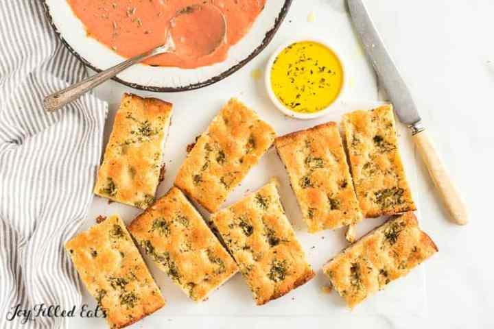 pieces of keto garlic bread next to soup