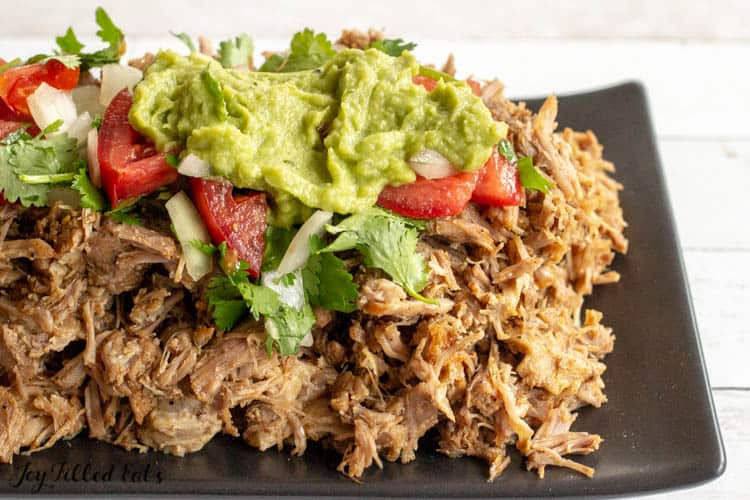 Instant Pot Carnitas topped with pico and guac