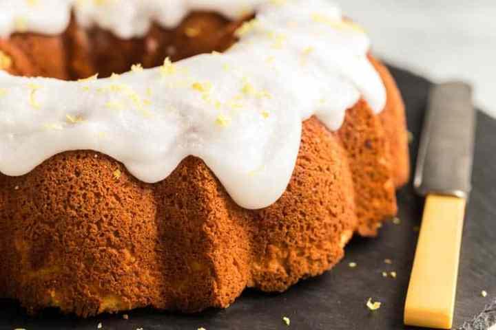 the lemon bundt cake with lemon glaze on a serving platter