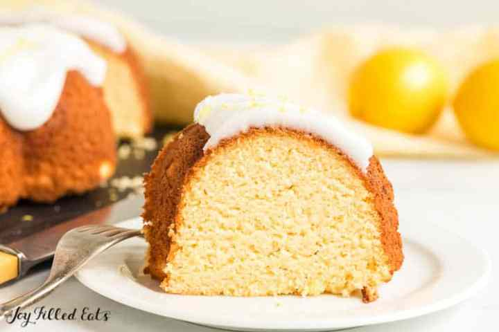 a slice of Lemon Drizzle Cake on a white plate