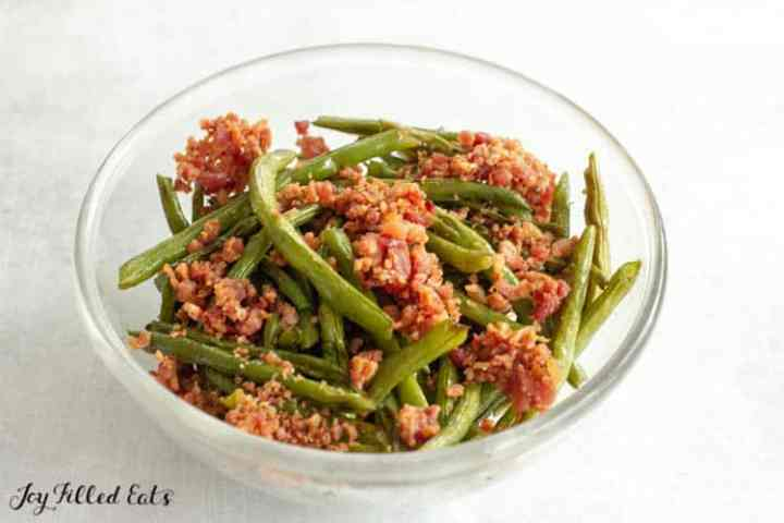 Oven-Roasted Green Beans in a glass bowl with bacon