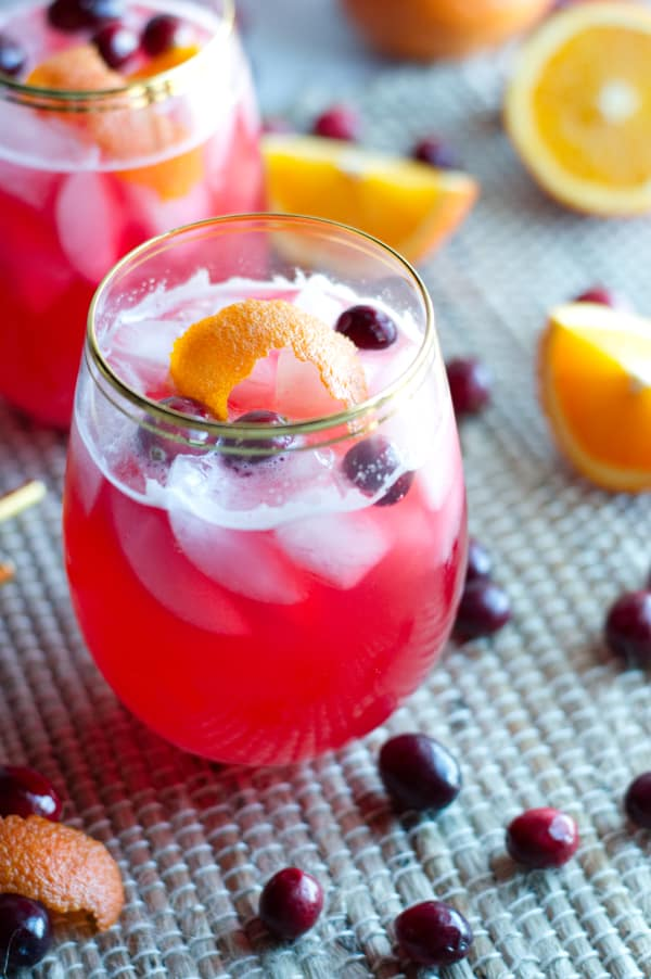 glass with Vodka Cranberry Spritzer with cranberry and orange peel
