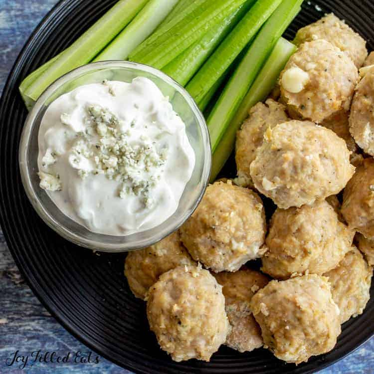 plate of Buffalo Chicken Meatballs with blue cheese dressing and celery