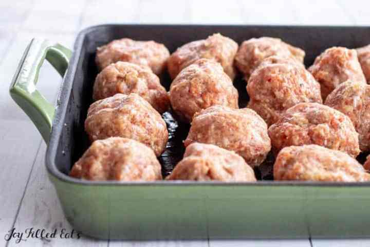 meatballs stuffed with cheese in a roasting pan