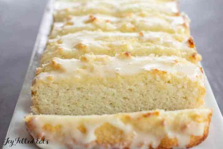 keto vanilla cake sliced on a white plate