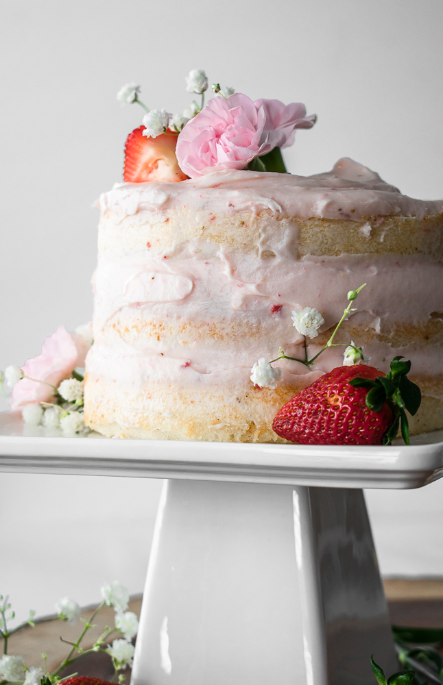 Layer cake on a white cake stand