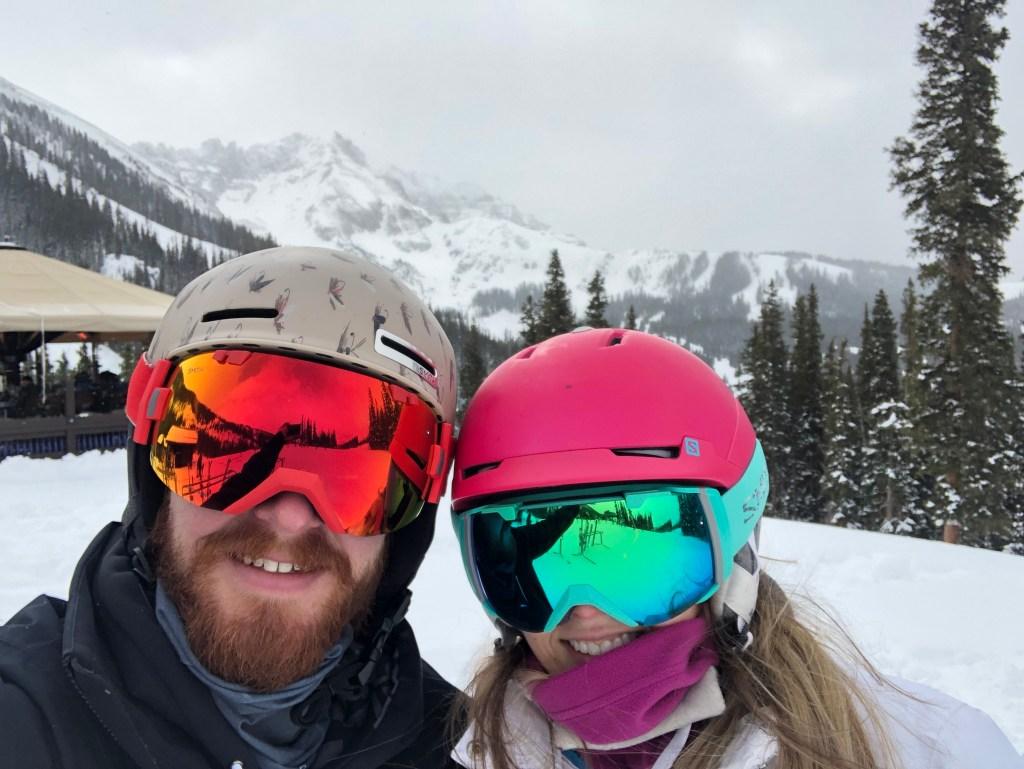 Skiers wearing 3-in-1 jackets
