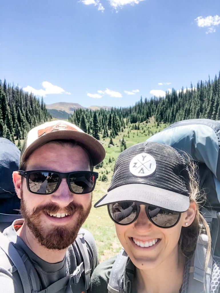Nathan and Amy with backpacks on their first backpacking trip in the San Juan Mountains