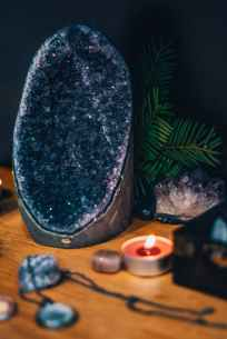 A rich, gorgeous amethyst geode sits on an altar. There is a tea light candle burning, and some plant leaves framing it. Joyful Empath can accent your best traits with therapy for empaths in San Francisco, CA. I offer HSP therapy, intuitive therapy, therapy for empaths, and other services. Contact me today for support with being a highly sensitive person.
