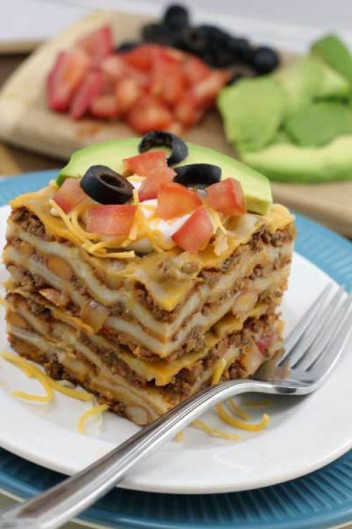 Layered Enchilada Casserole on plate with Fork
