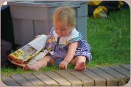 Pickin' grass and readin' the paper.