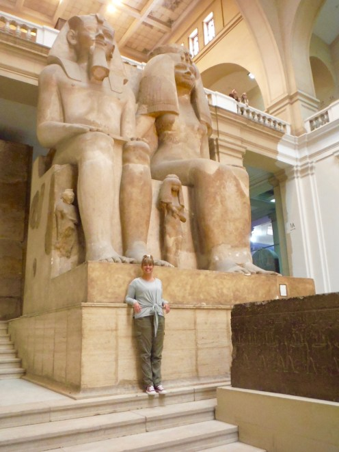 Colossal group of hard limestone of King Amenophis III and his Queen Tyi and their 3 daughters.