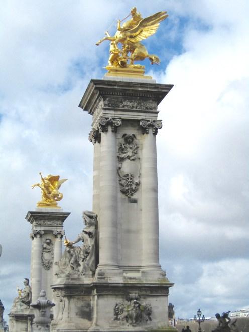 Left Bank Fames, the entrance to the Pont Alexandre III Bridge