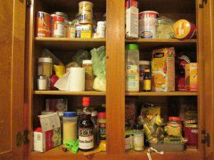 disorganized kitchen cupboard