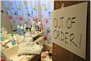 bathroom with out-of-order sign on door