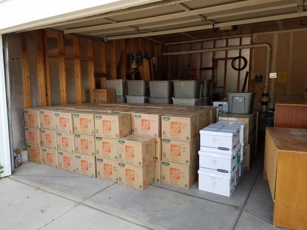 moving boxes neatly stacked in the garage