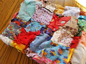 handmade quilt that's much the worse for the wear