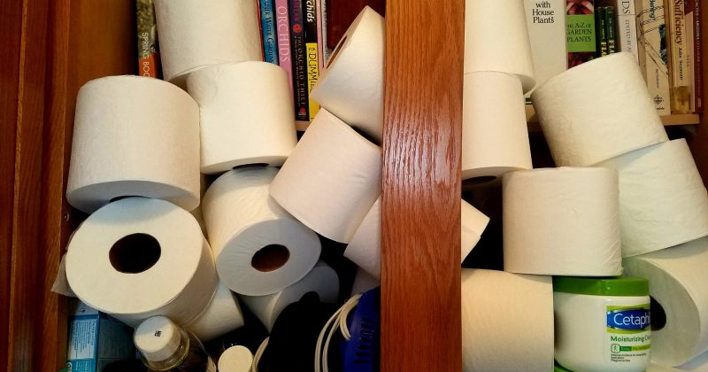 individual toilet rolls crammed into a bathroom cabinet jostling for space with over the counter medications