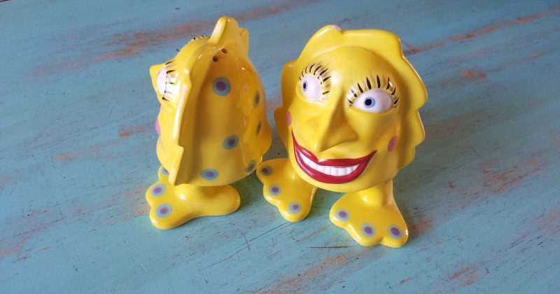 yellow porcelain salt and pepper shakers with smiling faces bright red lipstick