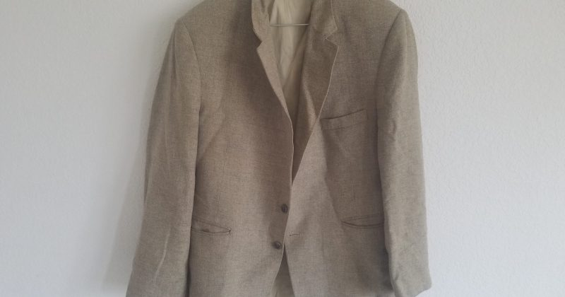 battered suit jacket that has been used for years