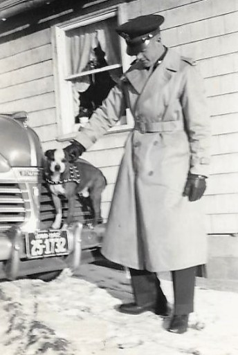 "Lt. Dale Wilson and his favorite pet, ""Spats."" ""Just before leaving for Des Moines to leave for Greenville, S.C. late trip home"""