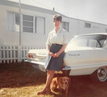 Joy beside the 10-foot-wide mansion, the 1963 Chevy Biscayne, with Muffy.
