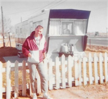 Guy in front of the 8-foot wide trailer, Mountain Home, Idaho.