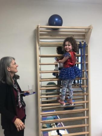 child climbing on exercise equipment at open house