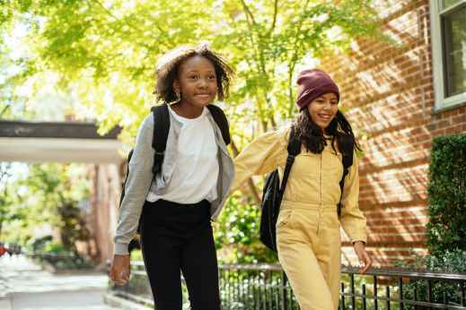 Two adolescents carrying backpacks