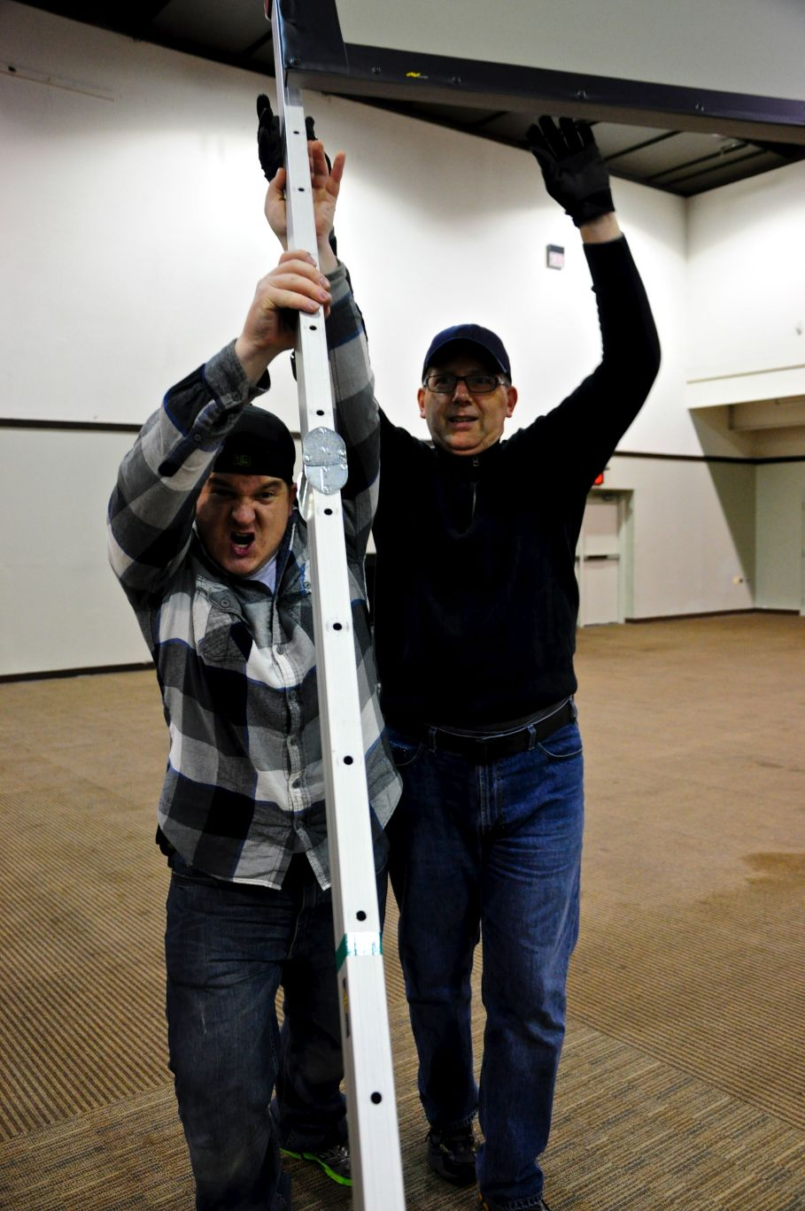 Zayne and Brent help raise one of our ginormous side screens.