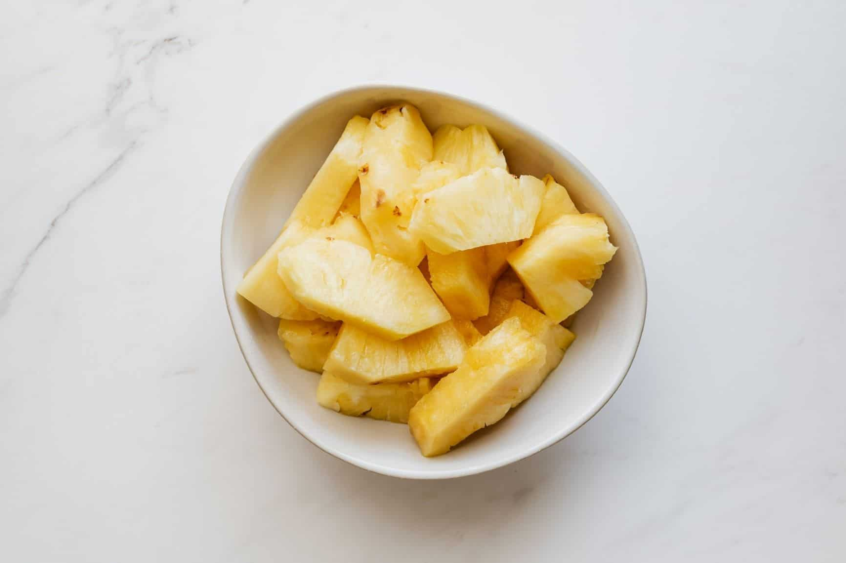 Pineapple slices in a bowl
