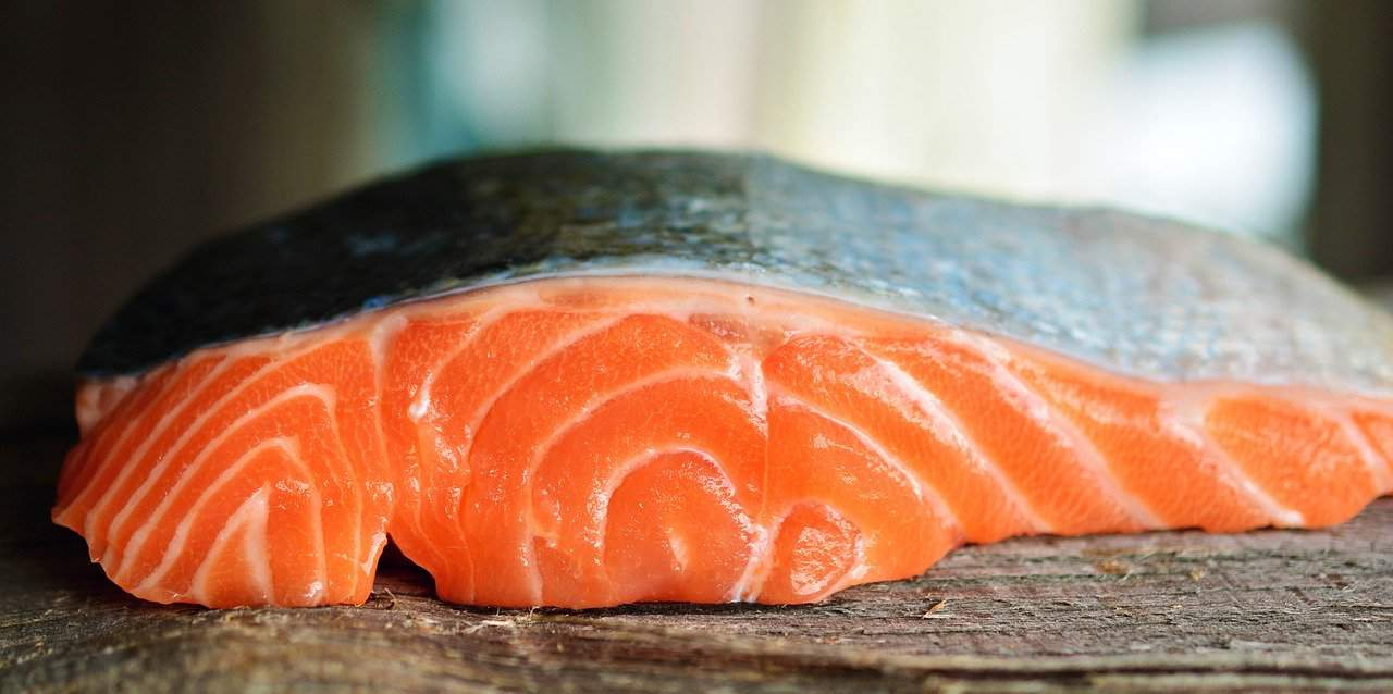 Raw salmon on a wooden tabletop