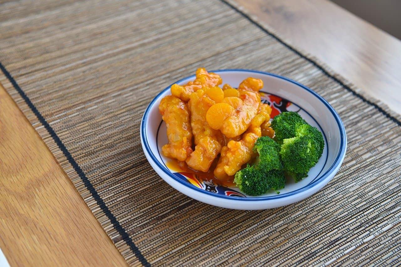 Orange chicken made healthier by the presence of broccoli