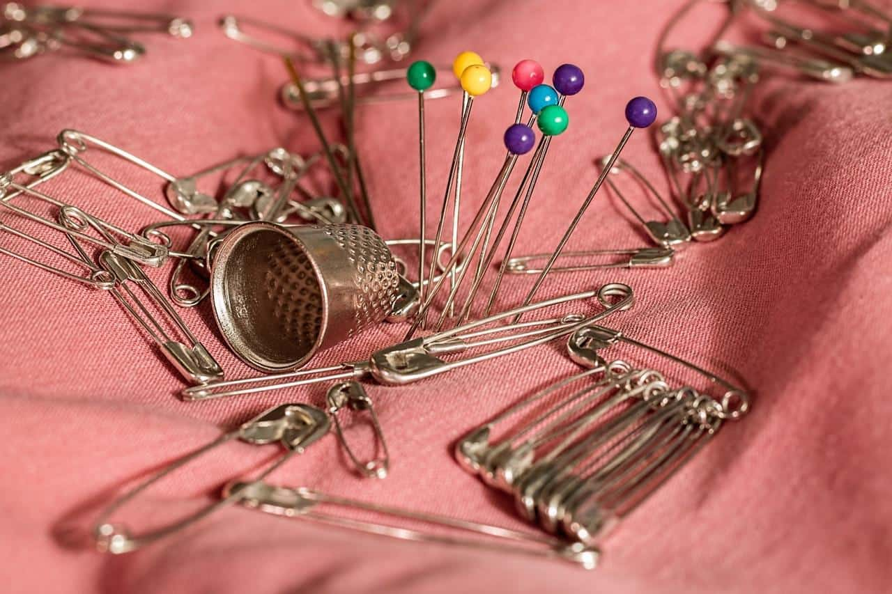 An assortment of pins, including safety pins