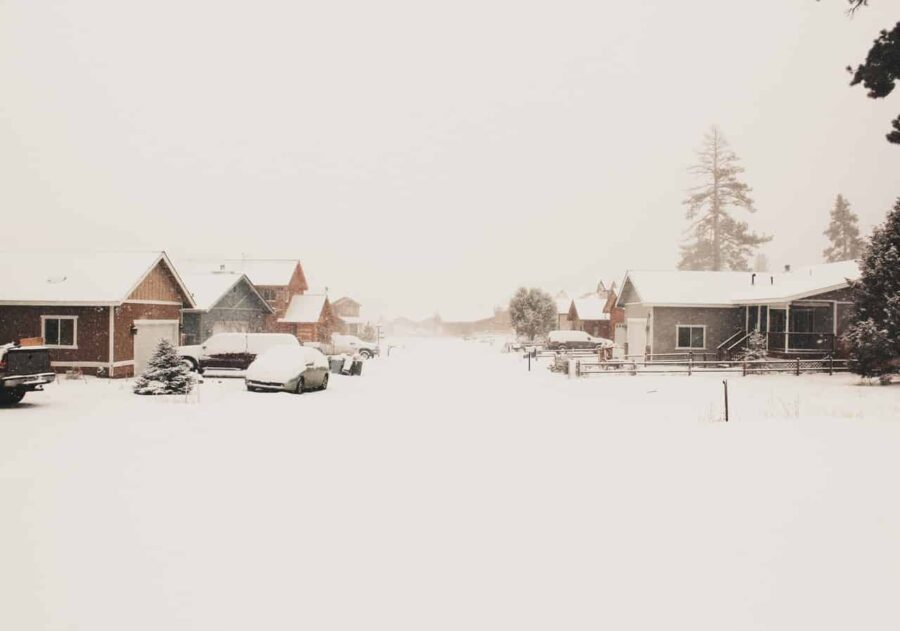 Brown houses surrounded by snow