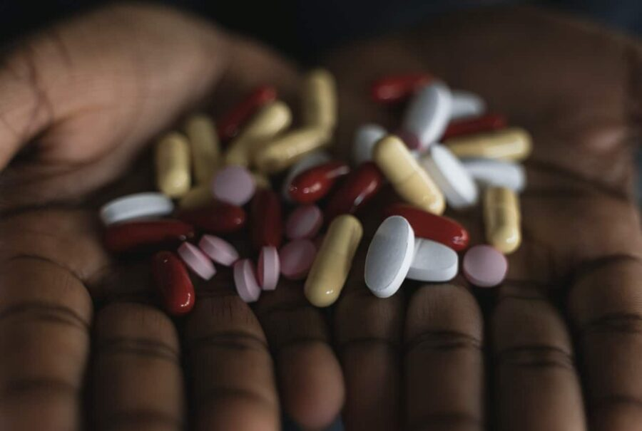 Handful of red and white medicines